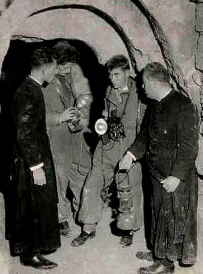 1957, Dr Peter J Shields (3rd left) with Fr. Victor (1st left) at St. Paul's Grotto, Melite. (Image: Courtesy Peter J. Shields)
