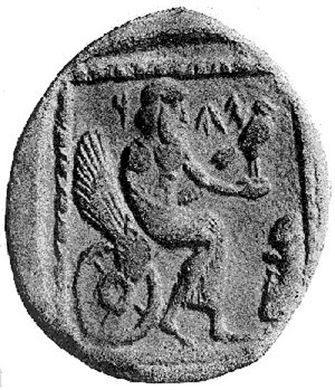 """A 4th century BCE drachm (quarter shekel) coin from the Persian province of Yehud Medinata, possibly representing Yahweh seated on a winged and wheeled throne. An inscription lies on the face of the coin, either a Phoenician inscription on the coin reading """"YHW"""" or an Aramaic inscription reading """"YHD"""""""