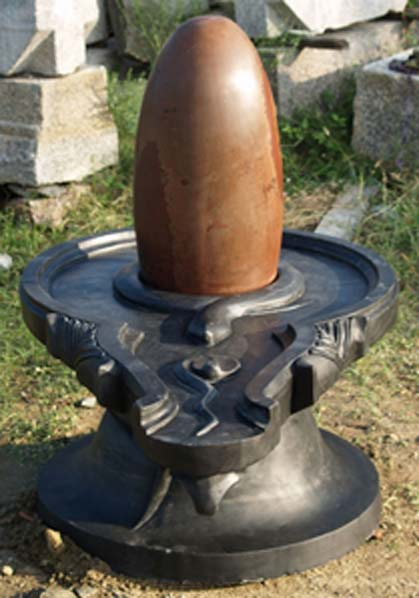 Figure 2. A Hindu lingam, basted with oils, in exactly the same fashion as Jacob's Pillar (Jacob's small conical stone).