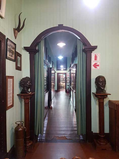 A dark passage extends from the haunted dark room to the old billiard room, which General Smuts converted into his study and library.