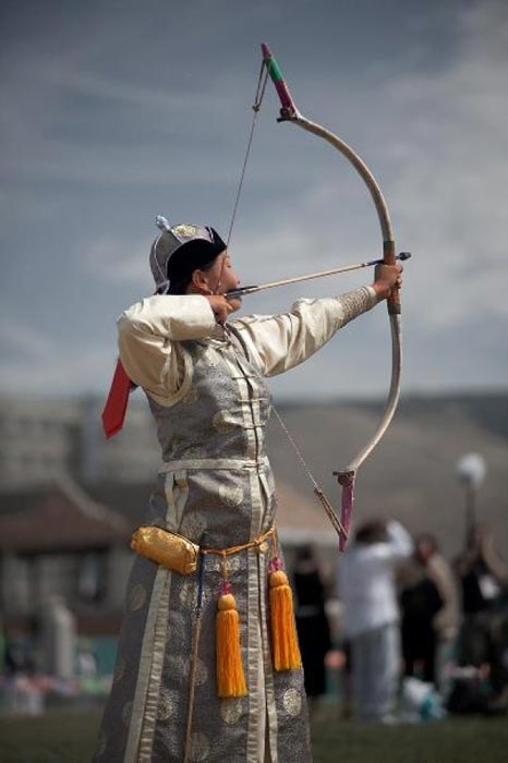 A female archer in elegant Mongolian dress during the Naadam Festival. (Pius Lee/Daily Travel Photos)