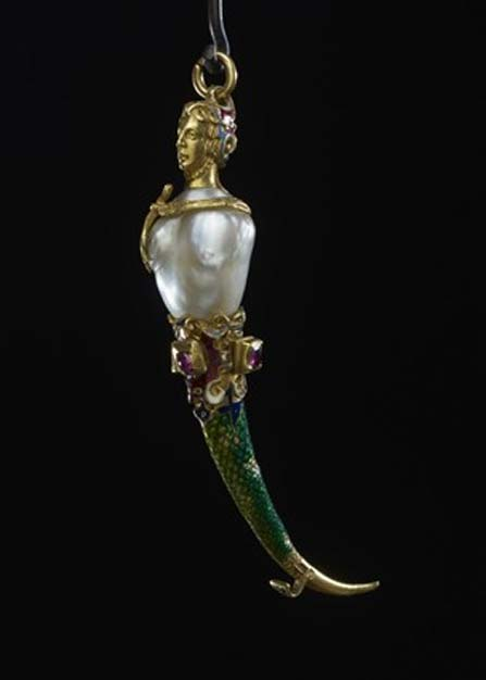 A luxury toothpick with ruby, pearl, and gold elements.