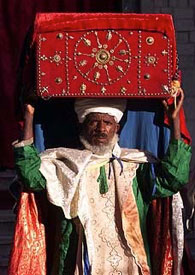 A man holds aloft a covered box for the Timkat procession.
