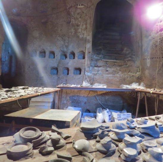 A medieval chamber for raising pigeons, called a columbarium, filled with excavated pottery