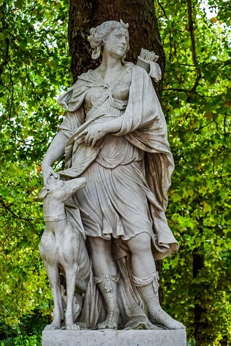 A statue of Artemis with many of her symbols. (CC0)