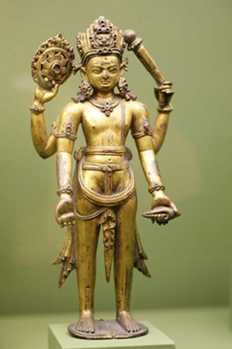A statue of Vishnu, with the Sudharshana Chakra in his upper right arm
