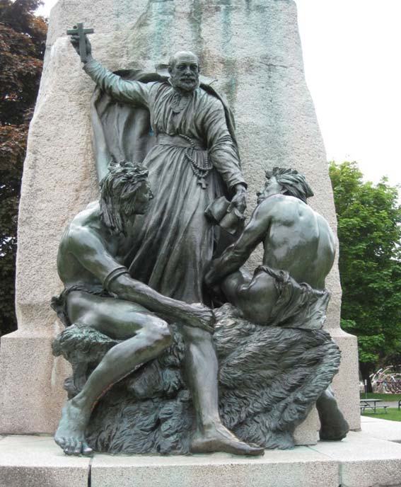 A statue showing a Jesuit priest and two indigenous people in Orillia, Ontario, Canada. (Author provided)