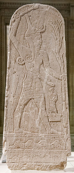 A stele of Baal with a thunderbolt found in the ruins of Ugarit. (Public Domain)