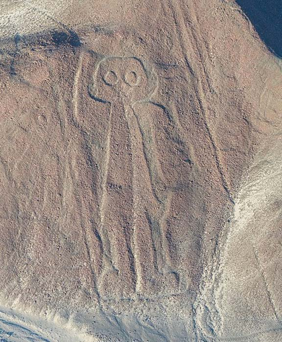 "Aerial view of the ""Owlman"" aka ""Astronaut"", the most enigmatic geoglyph of the Nazca Lines in the Nazca Desert in southern Peru."
