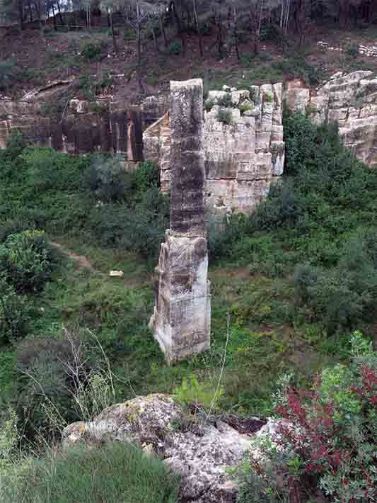 "The agulla de Mèdol: a 20 meter (65.6 feet) tall limestone column needle. The base of the rock ""needle"" is where the Roman quarry began, thus providing an estimation of the vast volumes of limestone quarried here in ancient times. (Enric / CC BY-SA 4.0)"