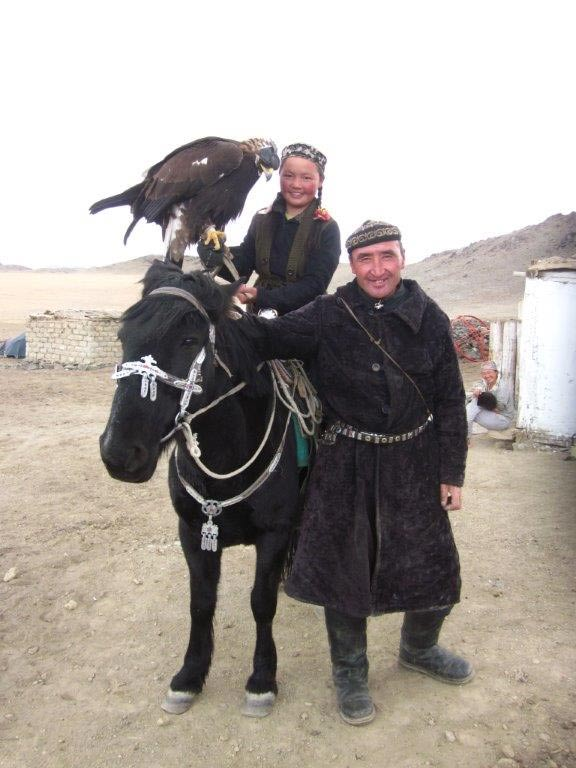 FIG 2.5. Aisholpan and her father Agalai, Eagle Festival, Ulgii, Mongolia, 2014.