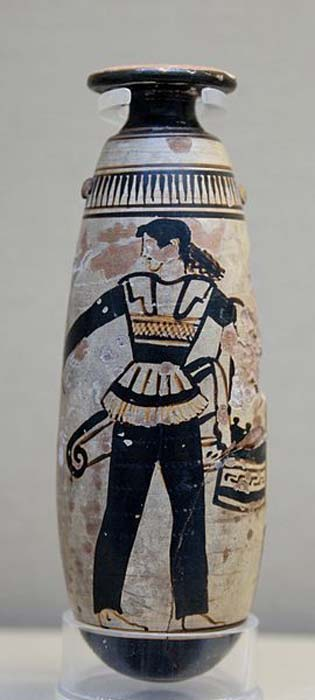 Amazon wearing trousers and carrying a shield with an attached patterned cloth and a quiver. Attic white-ground black-figured alabastron. (c. 470 BC)