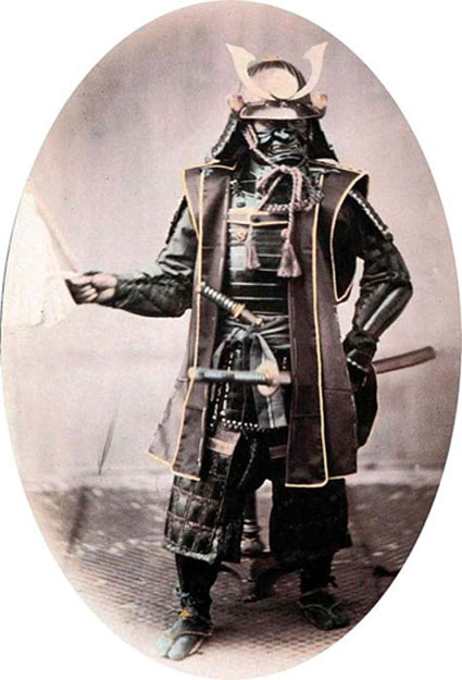 An 1860 photo of a samurai warrior in complete armor