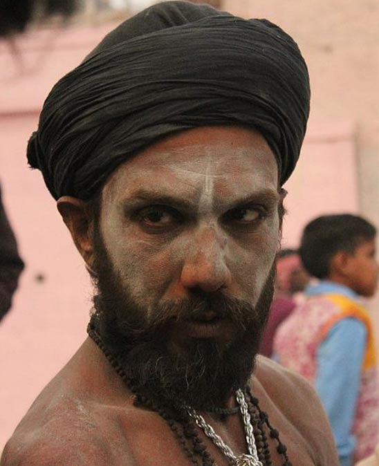 An Aghori with his face painted with human ashes in Varanasi, India.