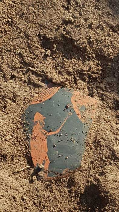An Attic vase fragment found at the Paestum site in southern Italy. It depicts the Greek god Hermes.