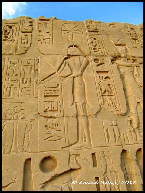 An elegant relief of goddess Seshat carved on the walls of Karnak Temple shows her dressed in her characteristic leopard-skin outfit. A scribe and record-keeper, she was worshipped as the deity of wisdom, knowledge, and writing.