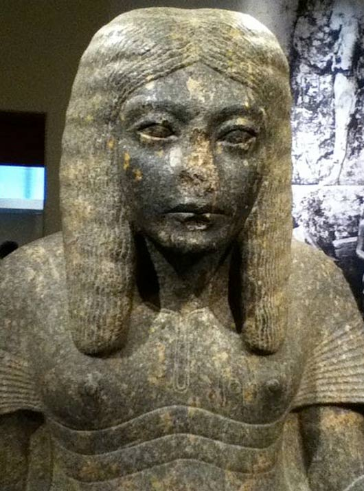 Who or what damaged this statue of the Ancient Egyptian pharaoh Haremheb as a scribe? Did vandals take his nose?