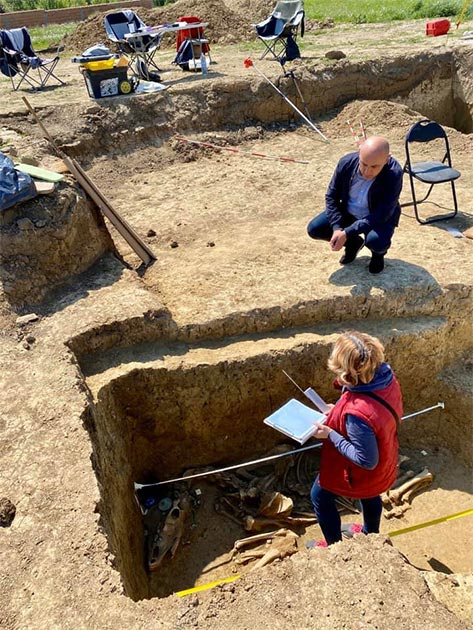 Archaeologists investigating the earthen Avar warrior grave at the excavation site in Croatia. (Ivan Bosancic)