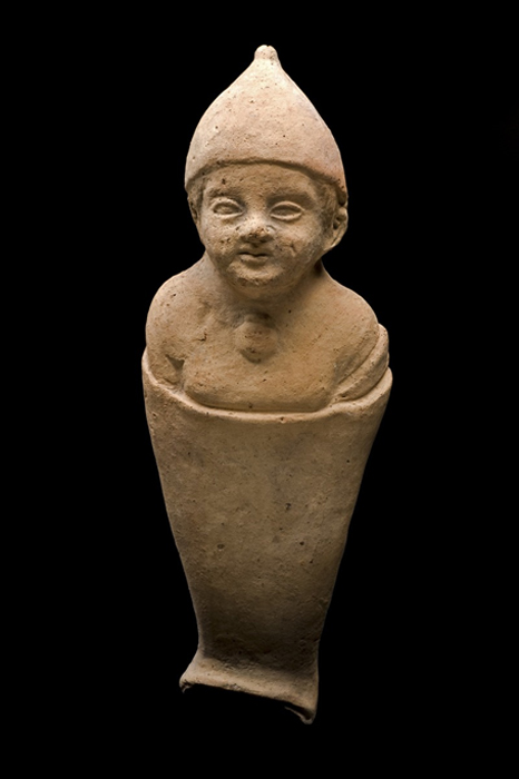 Babies like this one, depicted in swaddling clothes, were often found in healing temples and sanctuaries along with uteruses. Researchers think a votive like this may have been offered for a sick infant to help make a woman become pregnant. Multitudes of womb votives have been found at temples to fertility goddesses, says Atlas Obscura.