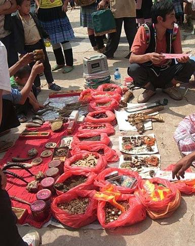 Bags of Illegal medicinal tiger products at the Laomeng market near Yuanyang county, China.