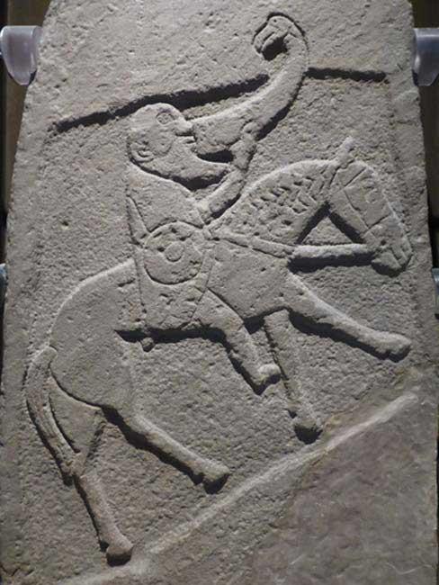 Bearded Pictish warrior from the Bullion Stone, Angus, now in the National Museum of Scotland. (CC BY SA 3.0 )