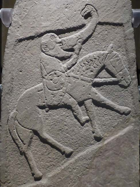 Bearded Pictish warrior from the Bullion Stone, Angus, now in the National Museum of Scotland.