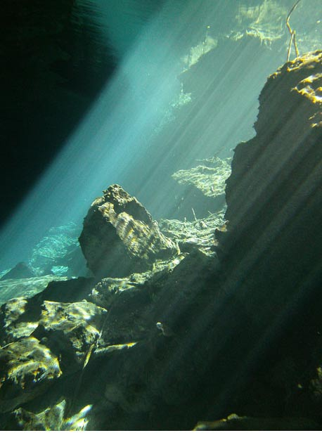 Beautiful cenotes, water-filled caverns beneath the ground in Mexico, are thought to have been sacred to the ancient Maya. Light underwater on the rocks Kukulkan Chac Mool Mexico.
