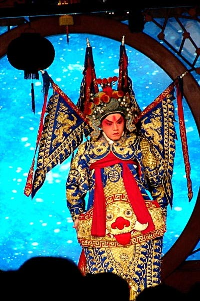 A Beijing opera performer with traditional stage make up.