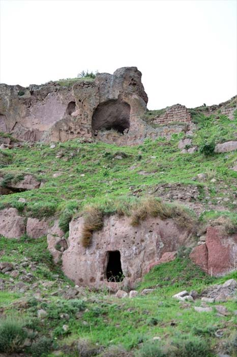 Entrances to Belağası Underground City and structures aboveground nearby.