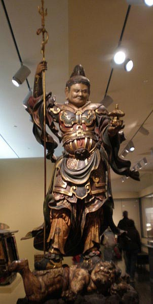 Wooden statue of Bishamonten stepping on a demon (1615-1700) on display at the Asian Art Museum in San Francisco, California.