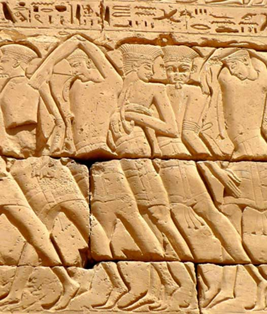 Bound Philistine prisoners of the confederation that comprised the Sea Peoples being paraded after their capture. Mortuary Temple of Ramesses III.  Medinet Habu.