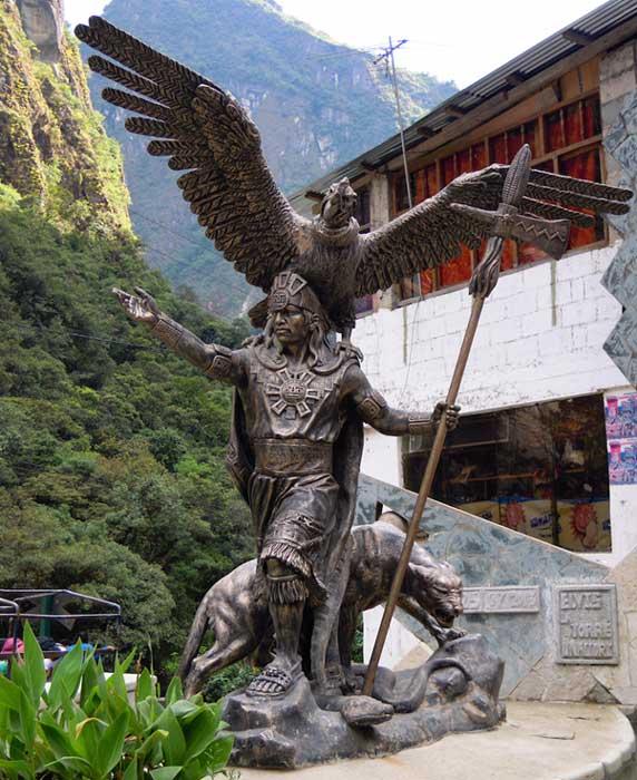 Bronze representation of snake, puma and condor near Machu Picchu
