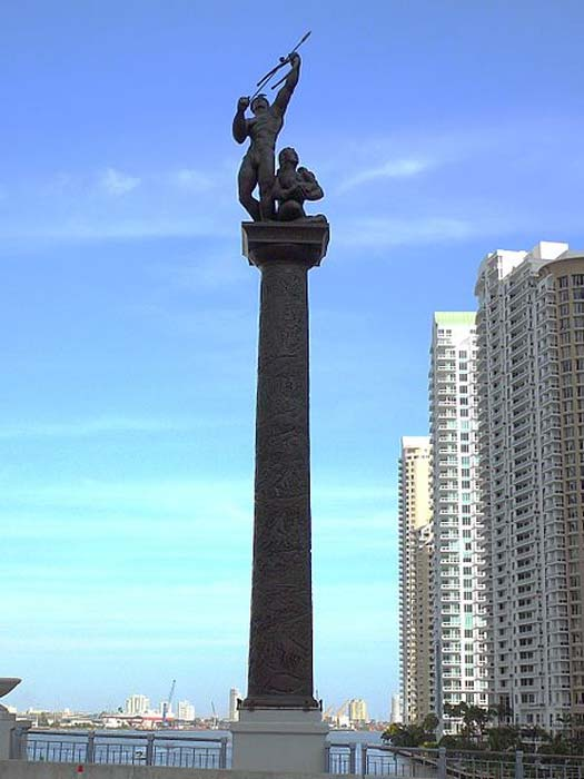 Bronze statue of a Tequesta warrior and his family on the Brickell Avenue Bridge in Miami, Florida. The sculpture was created by Manuel Carbonell.