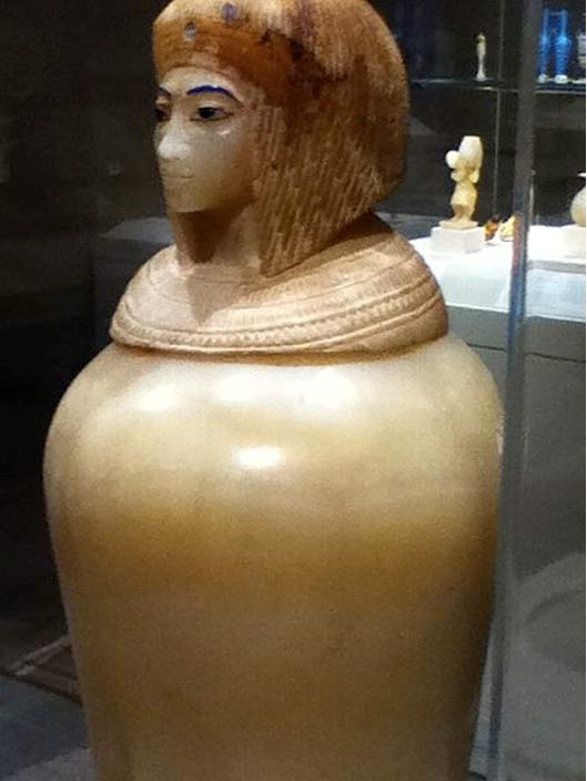 Canopic jar with the head of a carved woman, variously identified as Nefertiti, Tiye, Merytamen or Kiya