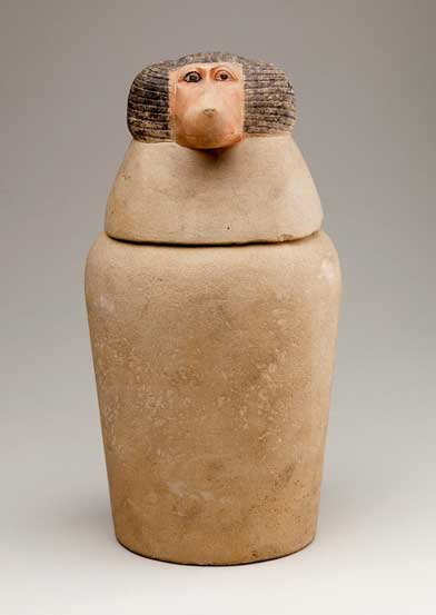 Canopic jars held the internal organs that were removed during mummification. This example, with its baboon-headed lid, held the lungs and was under the protection of the god Hapy, one of the Four Sons of Horus. 18th–20th Dynasty. Abydos. Metropolitan Museum of Art, New York.