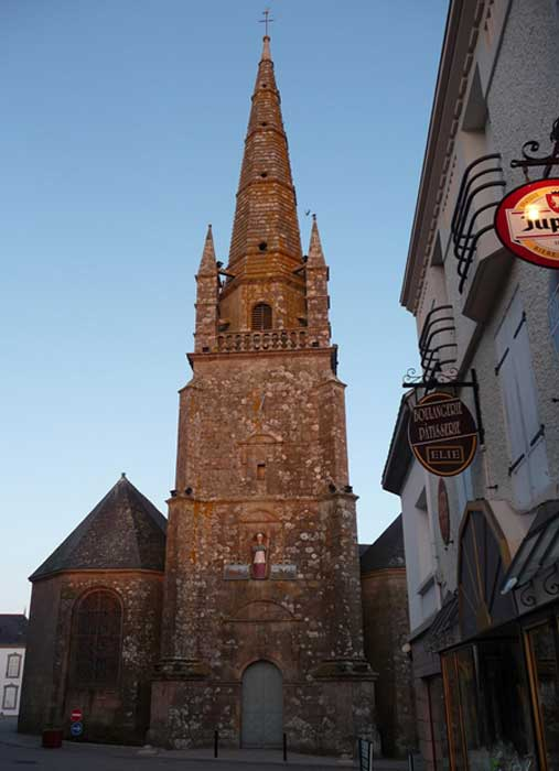 Carnac parish church, with its statue to St Cornèly half way up the tower (Photo: Anthony Adolph)