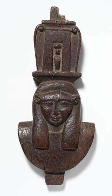 Carved cedar sculpture of the head of Hathor. (Egyptian 16th Dynasty)