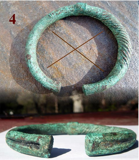 This photo is a Central European bracelet (300 BC) with an atypical shape, which features a plain design on one side and a more elaborate version (twisted bronze) on the other one. Two long abstract shapes of a triangle are engraved into each terminal, a deeper cut one the plain side and a less elaborate cut one on the twisted side, forming an encoded cross reference of an X.
