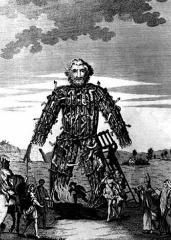 18th Century engraving of a Celtic wicker man, full of people, being lit on fire.