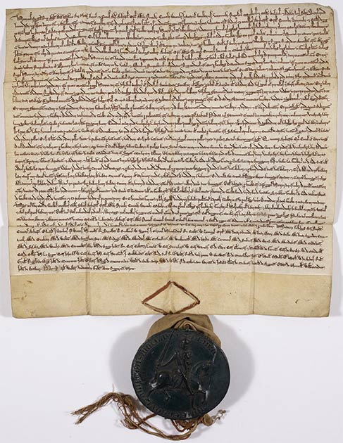 The Charter of the Forest, 1217, held by the British Library. (Public Domain)