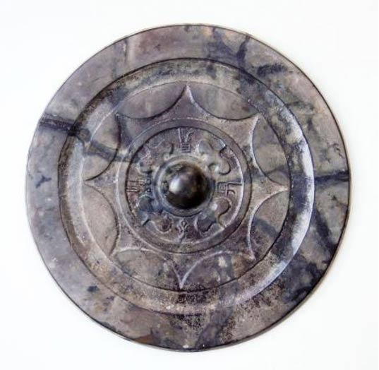 This Chinese-made bronze mirror was unearthed at an archaeological site in Fukuoka, Japan.