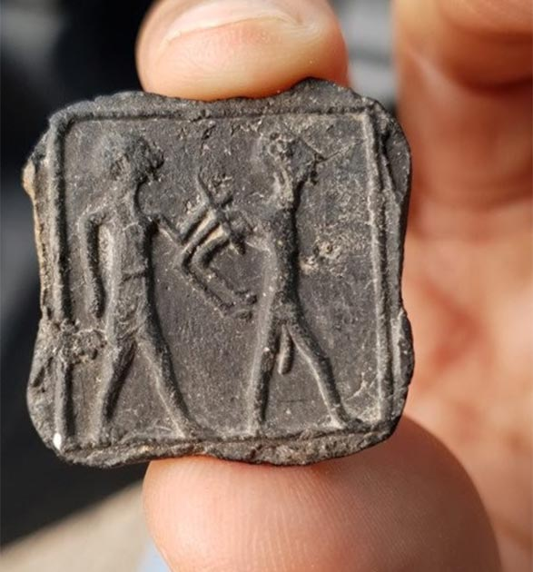 Clay plate late of captive and captive. (Israel Antiquities Authority)