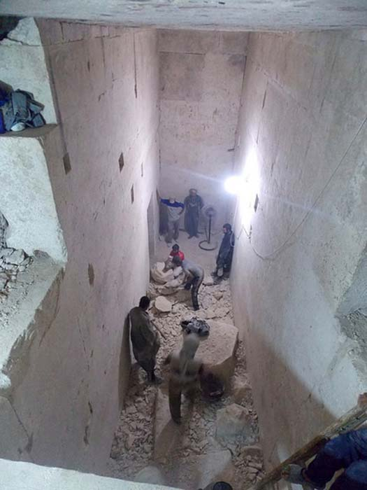 Clearance work in one of the chambers of the tomb.