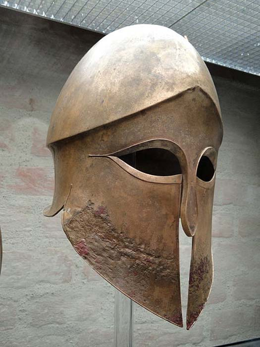 Corinthian helmet from the tomb of Denda. The name of the warrior (Denda) is engraved on the left greave. From a Greek workshop in South Italy, 500–490 BC. (CC0)