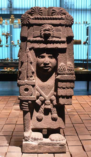Corn or pinecones? Aztec stone sculpture of the goddess Chicomecoatl; Ethnological Museum, Berlin, Germany.