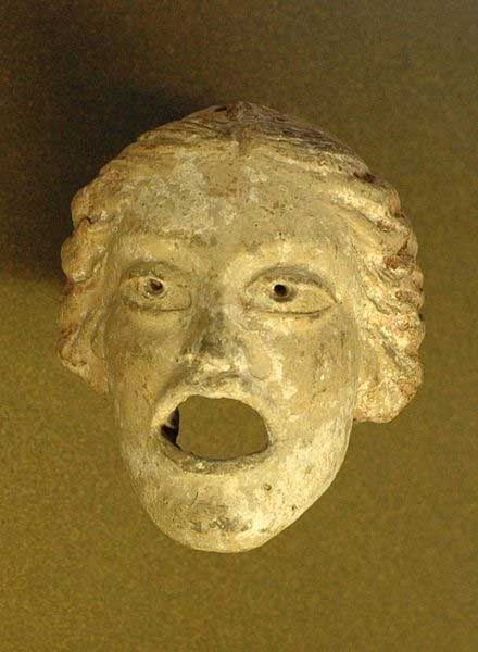 Courtesan mask or pseudokorē (Nr. 39 or 34 in Pollux' list), found in Cyrenaica (now in Libya). Terracotta, 3rd–2d centuries BC. (Public Domain)