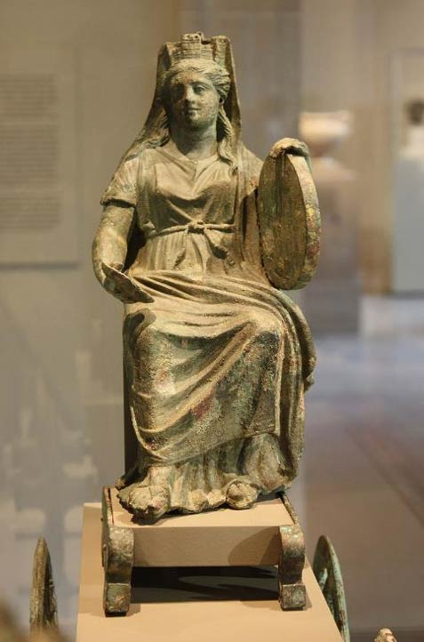 Cybele holding a tympanum in her left hand.