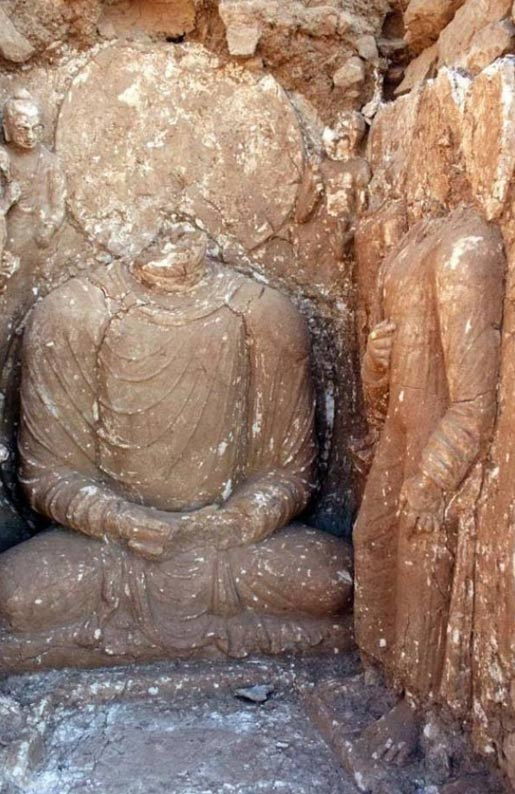 Damaged stucco sculptures of Buddha at Bhamala.