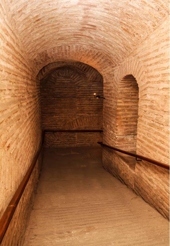 Dark hallway with polished pebbles on the floor passageway inside Hagia Sophia Basilica