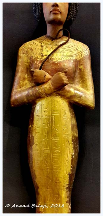 Detail from one of Tutankhamun's shabtis inscribed with Spells from the Book of the Dead. Amarna artistic influence notwithstanding, the prominent breasts and low slender hips of a few examples, including this one, have led some experts to suggest it was made for a female predecessor. Egyptian Museum, Cairo.